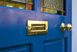 Leafleting and flyers: blue door with a gold letterbox