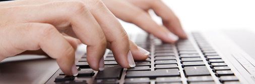 Writing for websites - fingers typing on keyboard