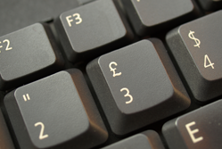 A pound sign on a grey keyboard