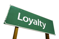 Customer loyalty schemes - a green sign saying loyalty
