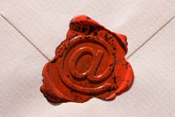 An @ sign in a wax seal
