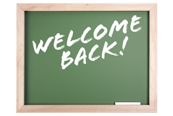 Welcome back! written on a black board