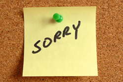 Sorry written on a post-it note