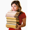 Woman carrying a pile of books