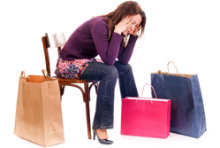 Woman with shopping bags looking sad