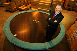 PPC advertiser Andrew Jardine standing on a trampoline