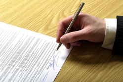 A man signing a contract{{}}