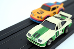 Toy racing cars competing
