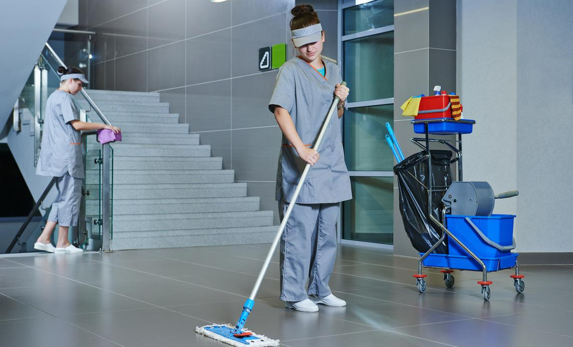 Contract cleaning business mopping the floors in a big office block