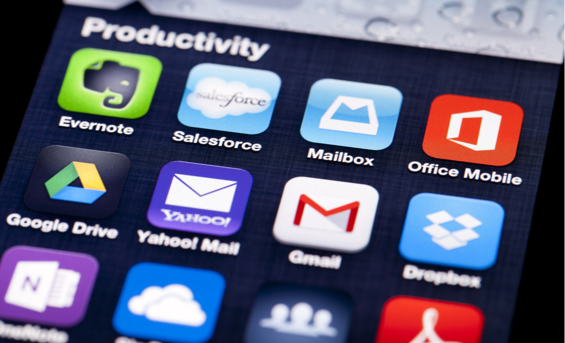 Productivity apps on a smartphone help a young entrepreneur run their business more efficiently