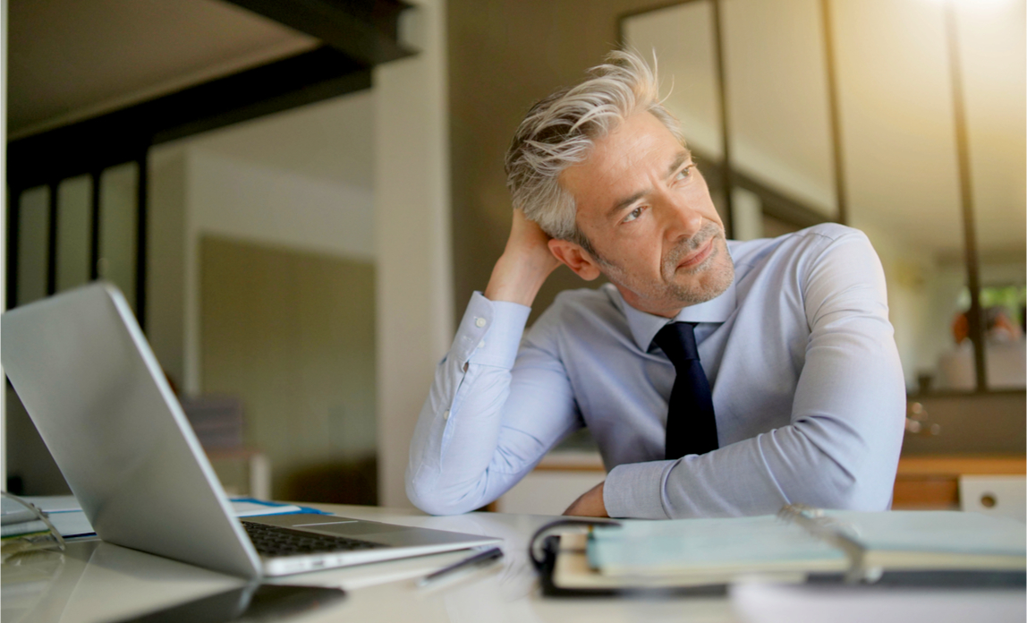 A frustrated businessman reviews his website and can't understand why it ranks badly in search.