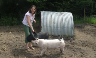 Julia Lowe with pig on her farm