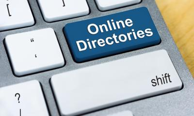 White keyboard white a blue 'Online Directories' key