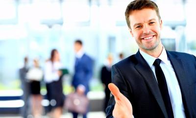 Man in suit reaching out to build rapport with a customer