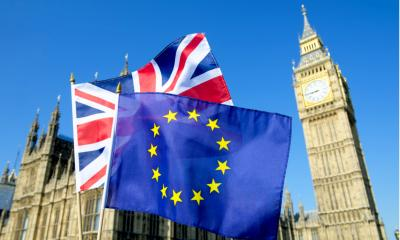 European Union and the United Kingdom flag flying in front of big ben