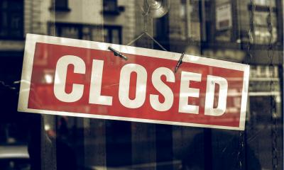 A closed sign in shop window