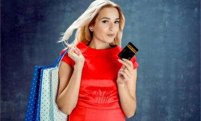 An attractive woman uses her loyalty card when she goes shopping