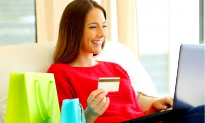 A female customer enters her payment card details online