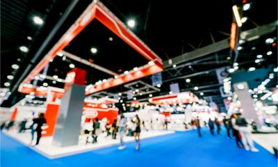 Blurred image of an exhibition hall and attendees