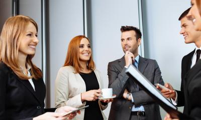 Group of employees in suits networking with each other