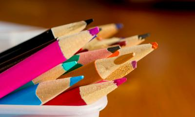 Lots of multicoloured pencils grouped together