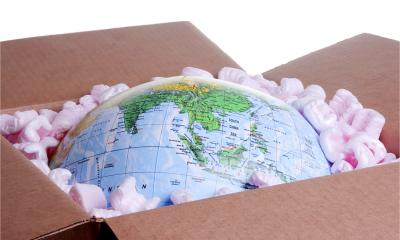 A globe is packed into a cardboard box, packaging solutions