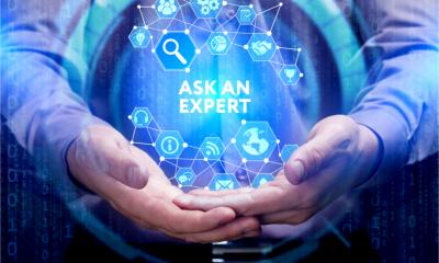 SEO concept: a young businessman shows the words 'Ask an expert' on a virtual display