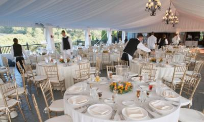 Tables set at an outdoor wedding after party