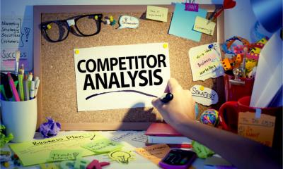 Competitor analysis written on a pin board