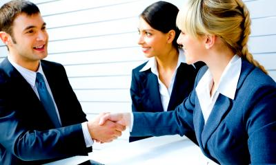 Business people shake hands on a new sales agreement