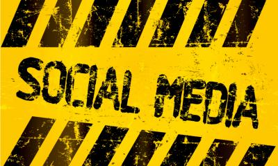 A yellow and black sign with the words Social Media printed on it