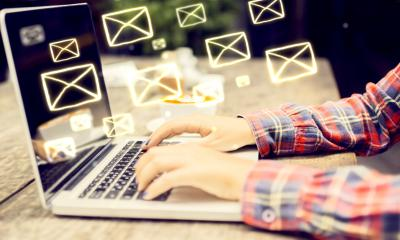 Typing on laptop - The benefits of sponsoring an email newsletter