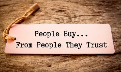 A product label which says 'People buy from people they trust'