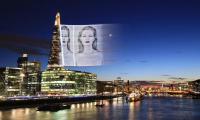 A virtual advert appears in the sky over the city