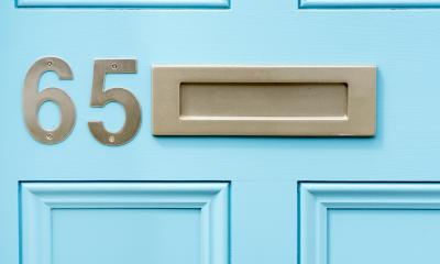 A letterbox in a pale blue front door