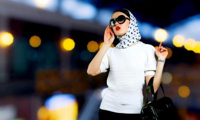 Fashionable women wearing a head scarf on a call