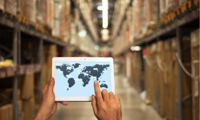 A person looking at a world map in warehouse setting