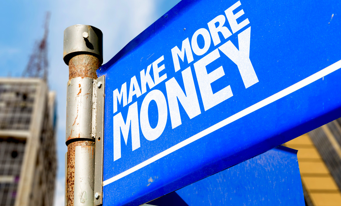 Blue road sign saying MAKE MORE MONEY