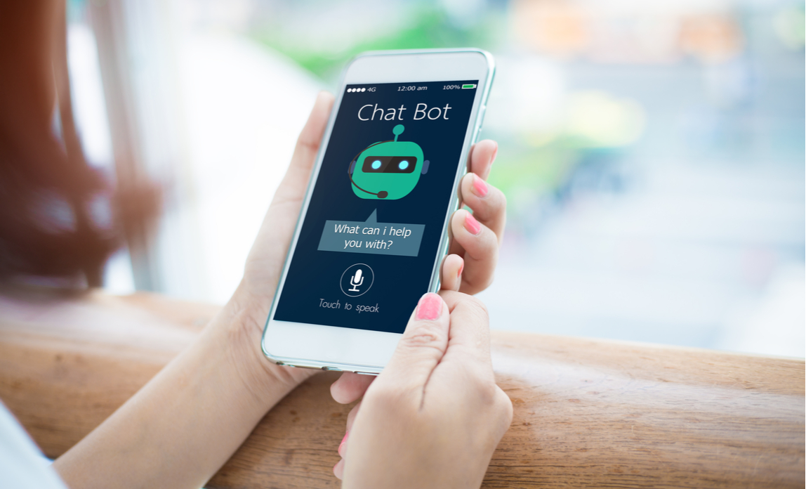 A young woman interacts with an AI chat bot from her smartphone